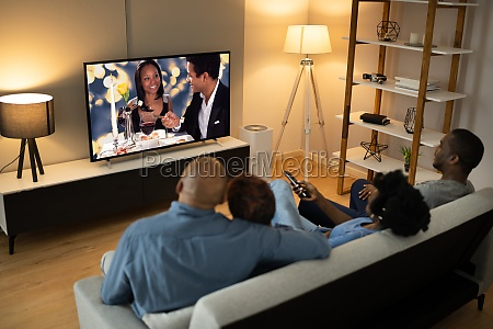 african family watching tv movie