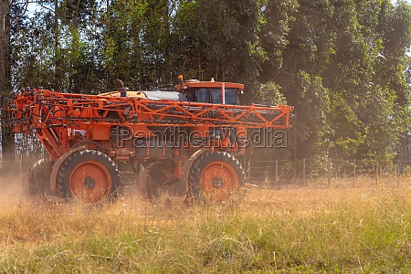 agricultural sprayer moving on a dirt