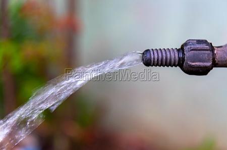 garden faucet spouting water