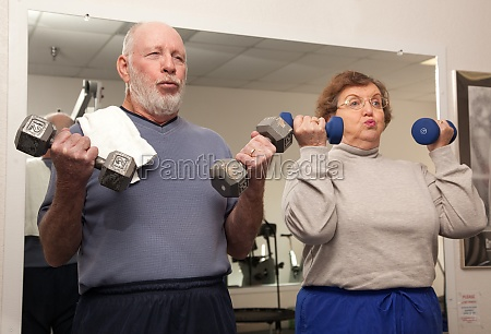 senior adult couple working out