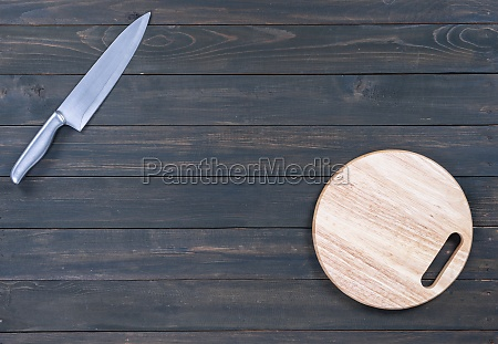 kitchen knife and wooden round empty