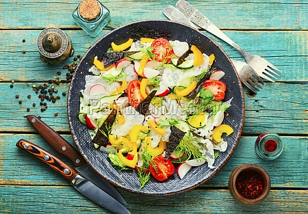 vegetable salad decorated with rice paper