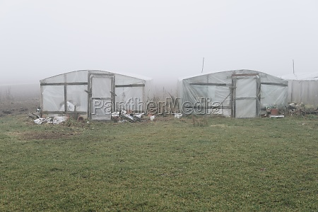 greenhouse in a field hidden in