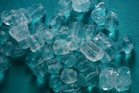ice cubes on blue backgroundcopy space