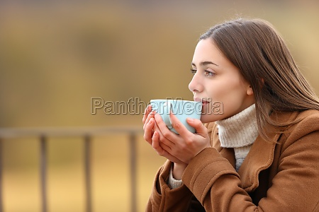 woman drinking coffee in winter in