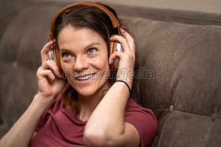 young woman enjoys music from wireless