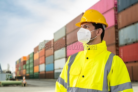 warehouse delivery man wearing face mask