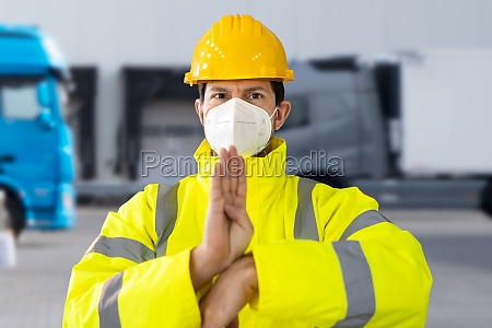 logistics worker in face mask