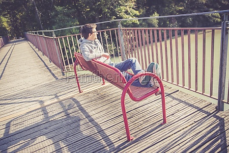 relaxation concept young man sitting on