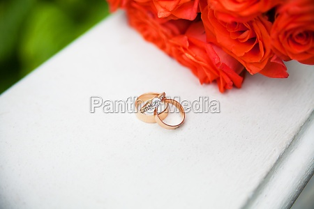 beautiful wedding rings and bouquet of