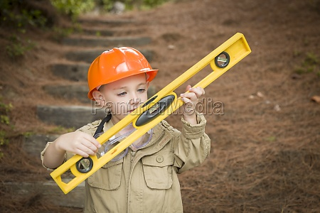 adorable child boy with level playing