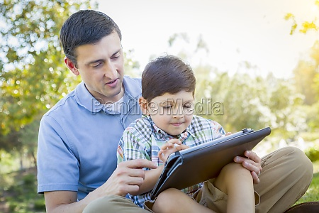 handsome mixed race father and son