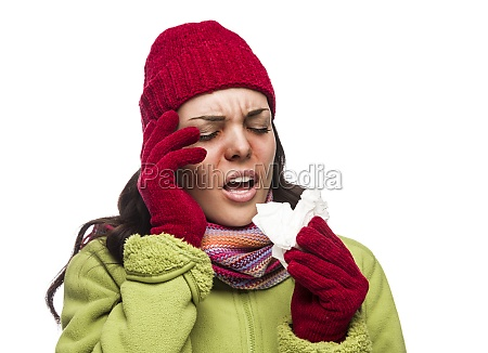 sick mixed race woman blowing her