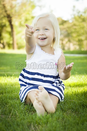 cute little girl sitting and laughing