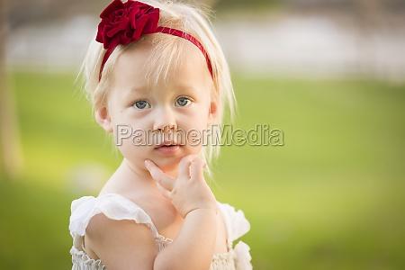 adorable little girl wearing white dress