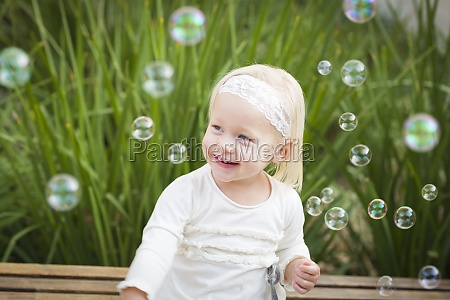 adorable little girl having fun with