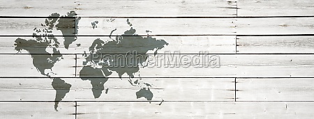 world map on white wooden wall