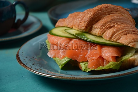 crispy croissant with salmon and lettuce