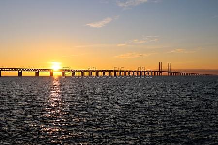 sunset sea and ship seen at