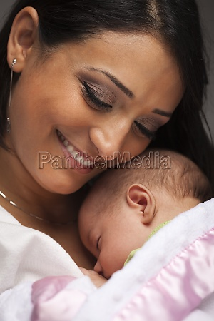 attractive ethnic woman with her newborn