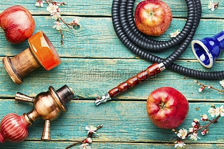 smoking hookah or shisha with apple