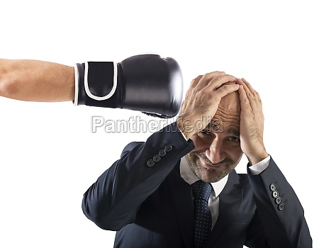businessman receives fists from competitors concept