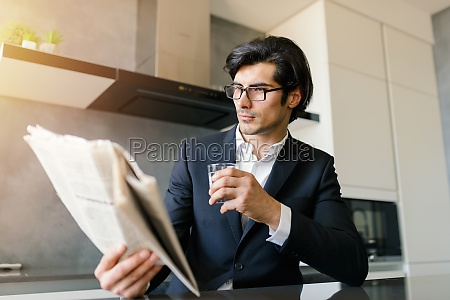 businessman read news from a newspaper