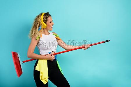 funny housewife use broom like a