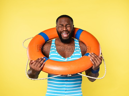 man with lifebelt is scared to