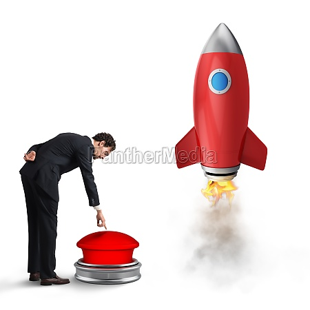 businessman launches rocket pushing a red