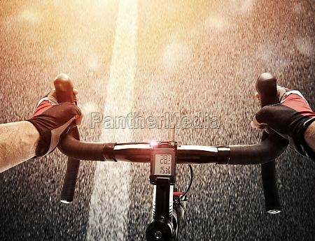 cyclist pedaling the bike on a