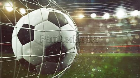 soccer ball scores a goal on