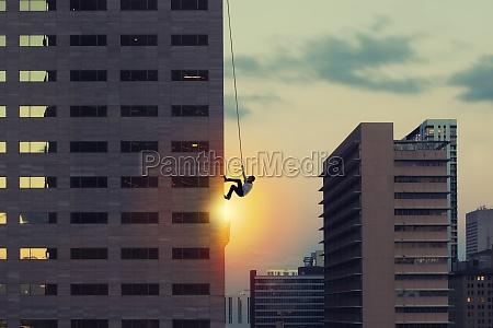 businessman climb a skyscraper achievement business