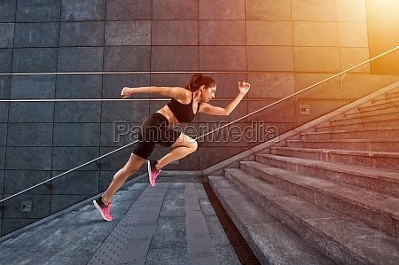 girl runs fast on a modern