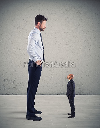 small businessman terrified by his big