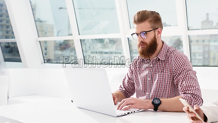 hipster businessman at the office working