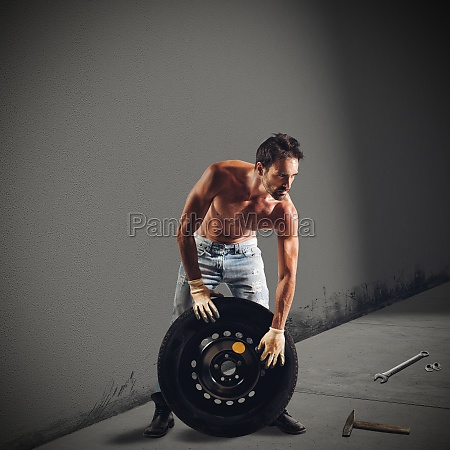 mechanic repairs the wheel