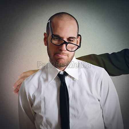 sad businessman comforted