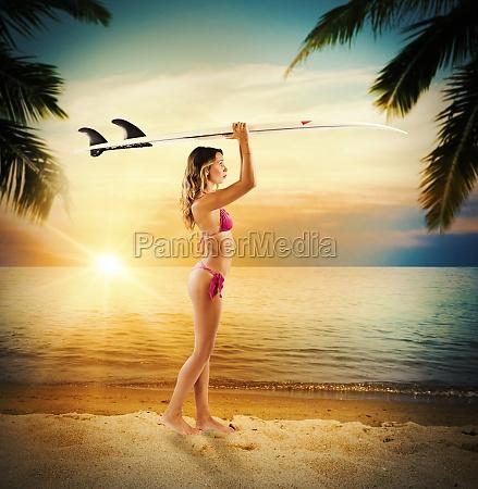 surfer girl in a tropical beach