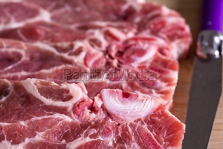 raw pork chop in a closeup