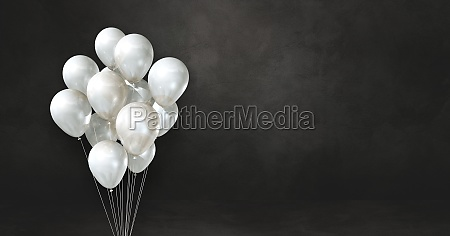 white balloons bunch on a black