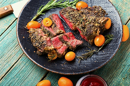 juicy beef steak with kumquat on