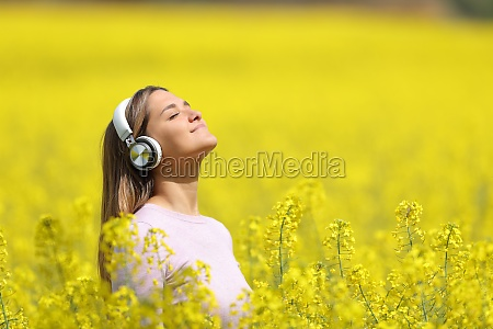 woman listening to music meditating in