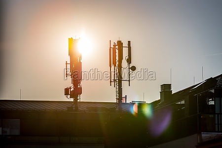 5g and communication tower silhouette of