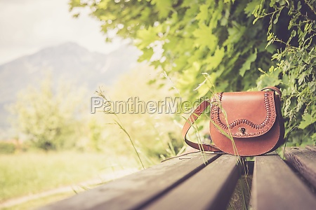 forgotten leather hand bag on a