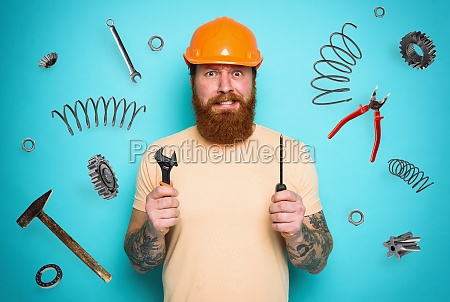 confused man with screwdriver and spanners