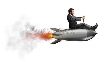 businessman flying over a rocket concept