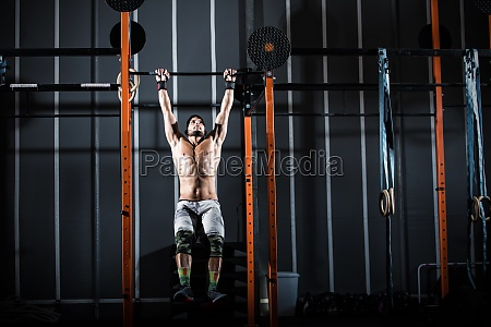 athletic man works out at the