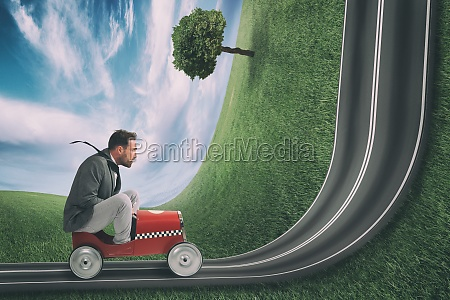 businessman climb an uphill road with