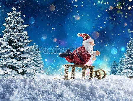 puppet santa claus on snow